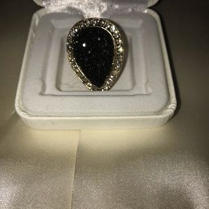 Guess ring unique never used or worn black gold